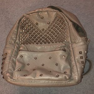 Spiked tan backpack